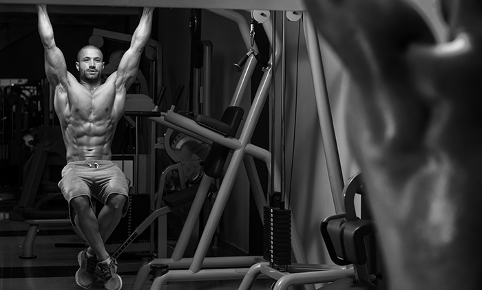 A man performing Pull Up Knee Raises